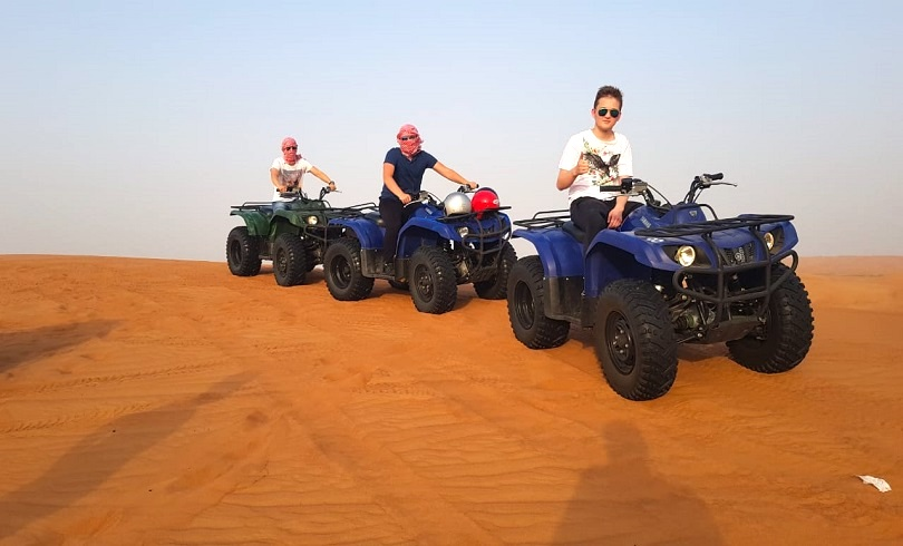 Dubai Desert Tour: ATV, Sand Surfing, and Camel Ride